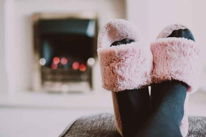 close up photography of person wearing pink house slippers